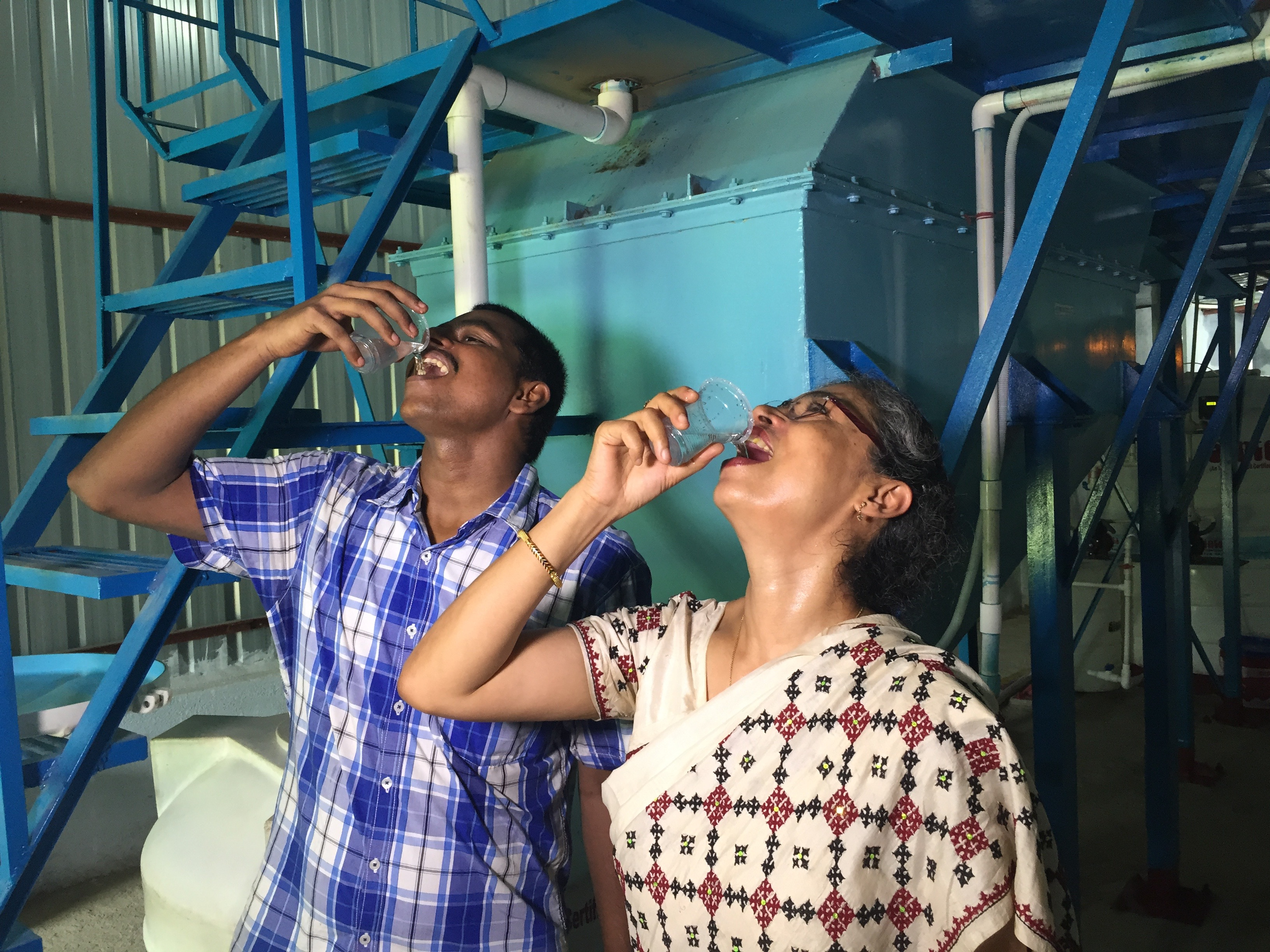 Tasting water treated by ECAR in India